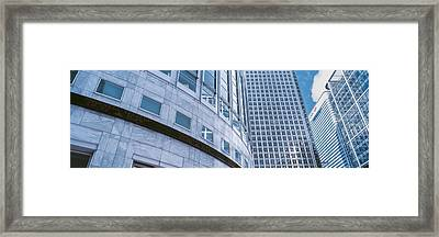 Skyscrapers In A City, Canary Wharf Framed Print by Panoramic Images