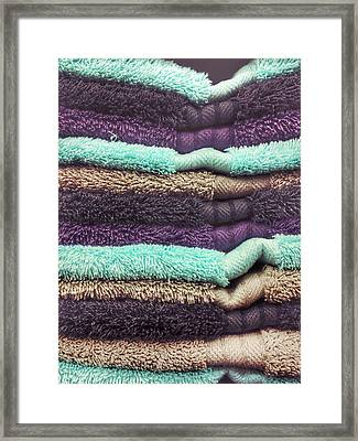 Stack Of Colourful Towels Framed Print by Tom Gowanlock