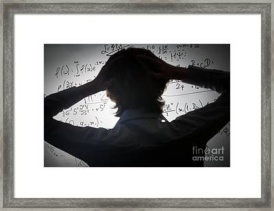 Student Holding His Head Looking At Complex Math Formulas On Whiteboard Framed Print by Michal Bednarek