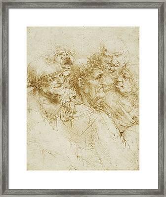 Study Of Five Grotesque Heads Framed Print by Leonardo da Vinci