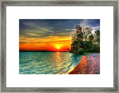 Sunset On The Shore Framed Print by Bruce Nutting