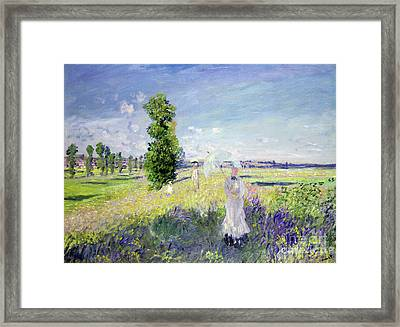 The Walk Framed Print by Claude Monet