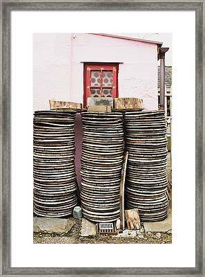 Wooden Discs Framed Print by Tom Gowanlock