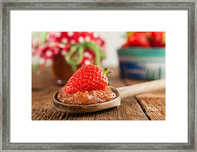 Wooden Spoon With Strawberry Jam And Strawberry Framed Print by Wolfgang Steiner