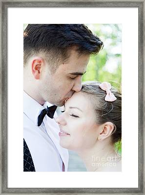 Young Handsome Man Gently Kissing His Fiancee Framed Print by Michal Bednarek