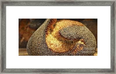 Freshly Baked Loaf Of Bread At A Bakery Framed Print by Oren Shalev