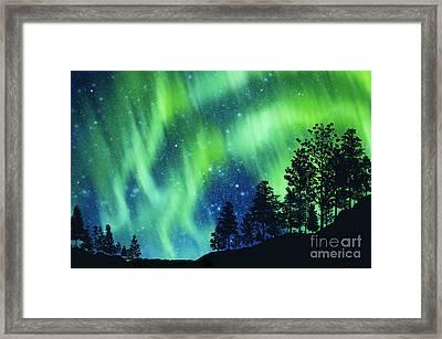 Aurora Borealis Framed Print by Setsiri Silapasuwanchai