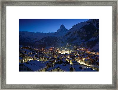 High Angle View Of Buildings Lit Framed Print by Panoramic Images