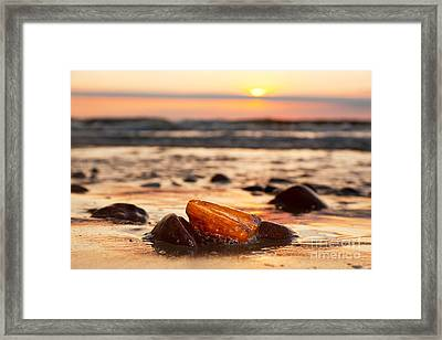 Amber Stone On The Beach Framed Print by Michal Bednarek