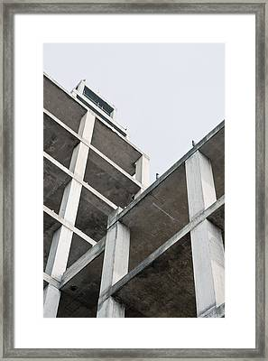 Building Construction Framed Print by Tom Gowanlock