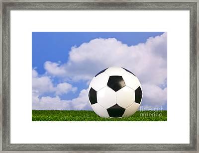 Football On Grass Framed Print by Richard Thomas