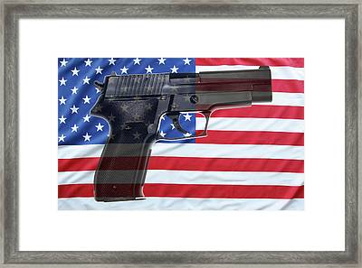 Gun And Flag Framed Print by Les Cunliffe