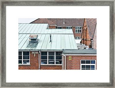 Red Brick Buildings Framed Print by Tom Gowanlock