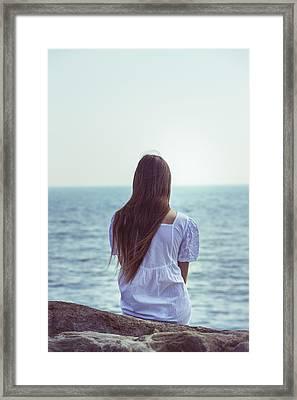 Sitting At The Sea Framed Print by Joana Kruse
