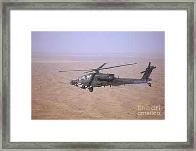 An Ah-64d Apache Longbow Fires A Hydra Framed Print by Terry Moore