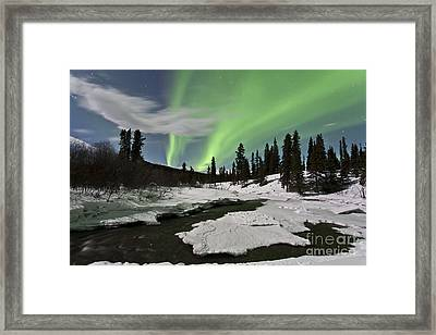 Aurora Borealis Over Creek, Yukon Framed Print by Jonathan Tucker