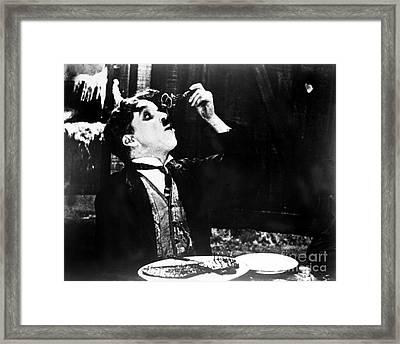 Chaplin: Gold Rush. 1925 Framed Print by Granger