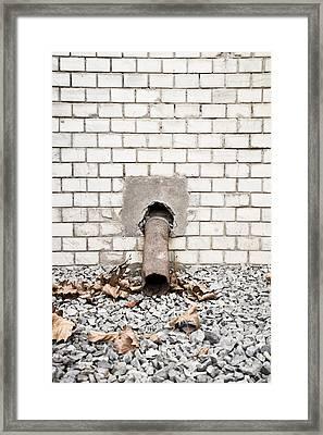 Rusty Drainpipe Framed Print by Tom Gowanlock