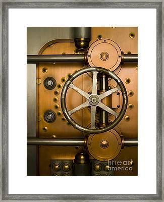Tumbler On A Vault Door Framed Print by Adam Crowley