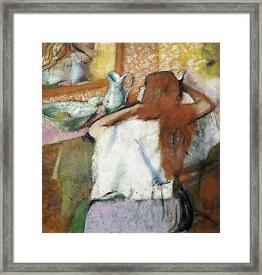 Woman At Her Toilet Framed Print by Edgar Degas