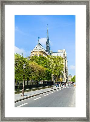 Notre Dame Cathedral Paris Streetside Framed Print by Nila Newsom