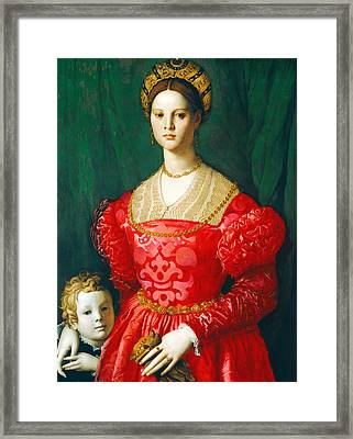 A Young Woman And Her Little Boy Framed Print by Agnolo Bronzino