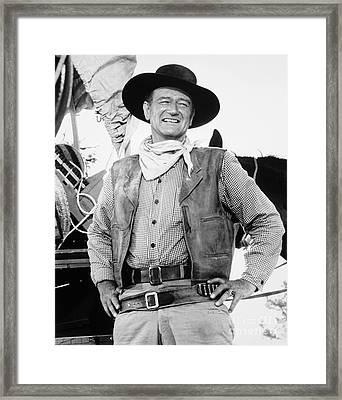 John Wayne (1907-1979) Framed Print by Granger