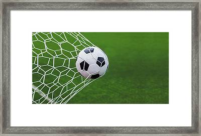 Soccer Ball In Goal  Framed Print by Anek Suwannaphoom