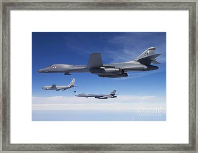 A B-1b Lancer Stands By As Another Framed Print by Stocktrek Images