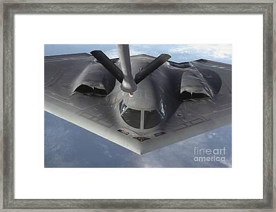 A B-2 Spirit Bomber Prepares To Refuel Framed Print by Stocktrek Images