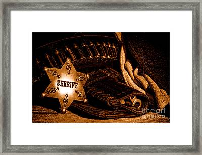 A Badge And A Weapon - Sepia Framed Print by Olivier Le Queinec