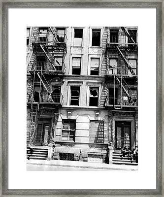 A Burned Out Apartment Building Framed Print by Everett