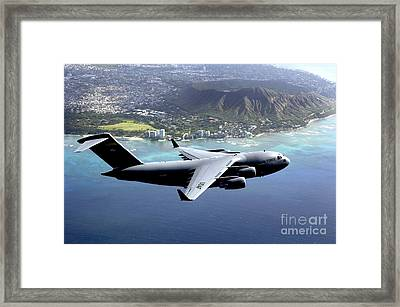 A C-17 Globemaster IIi Flies Framed Print by Stocktrek Images