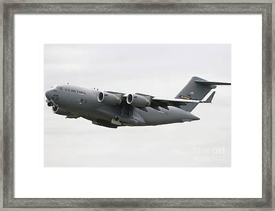 A C-17 Globemaster IIi In Flight Framed Print by Stocktrek Images