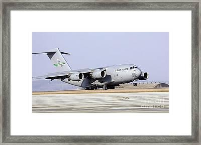 A C-17 Globemaster IIi Lands Framed Print by Stocktrek Images