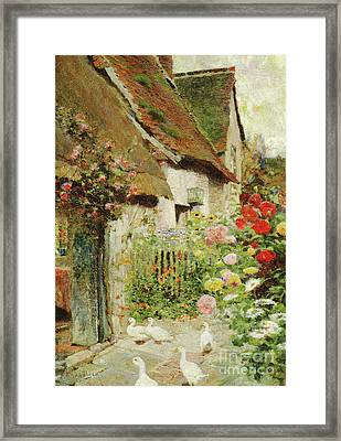 A Cottage Door Framed Print by David Woodlock
