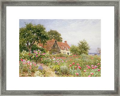 Bed Framed Print featuring the painting A Cottage Garden by Henry Sutton Palmer
