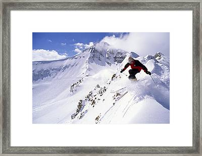 A Downhill Skier Launching Framed Print by Gordon Wiltsie