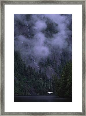 A Float Plane Comes In For A Landing Framed Print by Michael Melford