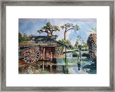 A Flooded Village Scene From Africa Framed Print by Usha Mishra