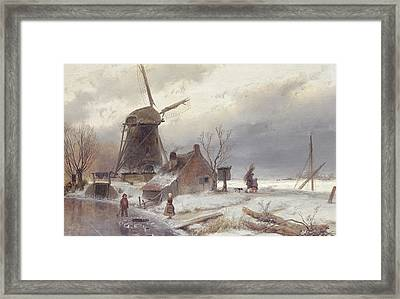 A Frozen River Landscape With A Windmill Framed Print by Andreas Schelfhout