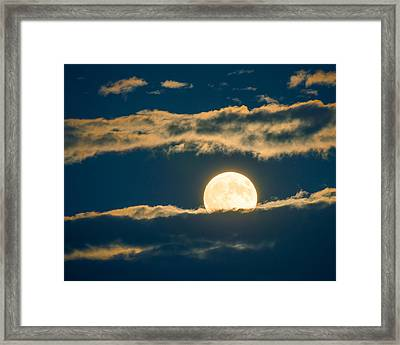 A Full Moon Ascends Behind Clouds Framed Print by Paul Duncan