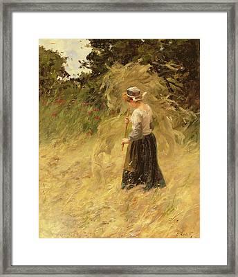 A Girl Harvesting Hay Framed Print by Eugene Leon Labitte
