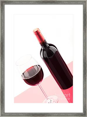 A Glass Of Red Wine With Bottle Framed Print by Wolfgang Steiner