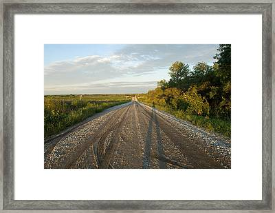 A Gravel Road Leads Away From A Farm Framed Print by Joel Sartore