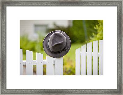 A Hat Hanging On The Post Of A White Framed Print by Lorna Rande