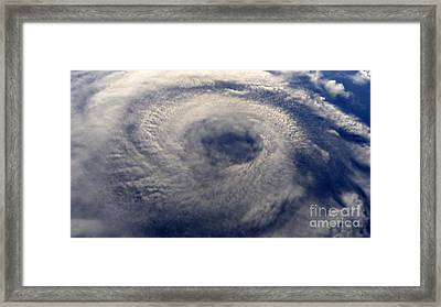 A Hurricane On Earth Viewed From Space Framed Print by Caio Caldas