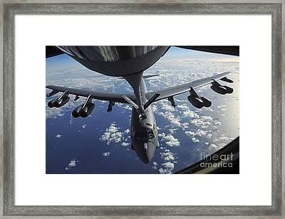 A Kc-135 Stratotanker Aircraft Refuels Framed Print by Stocktrek Images