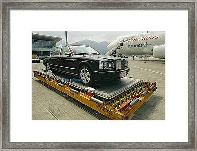 A Luxury Bentley Unloaded From An Framed Print by Justin Guariglia
