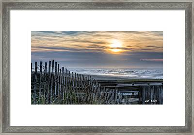 A Moment In Time Framed Print by Walt Baker